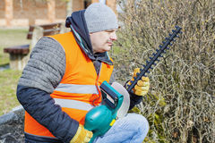 Landscape worker check bush cutter Royalty Free Stock Photos