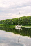 Landscape with yacht in the river Stock Photography