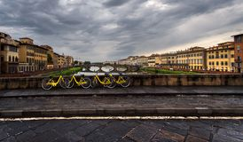Landscape with yellow bikes. View of the river Arno. Florence. Italy. Beauty of Italy stock image