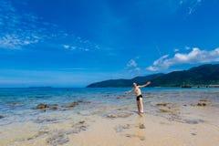 Tourist on Tioman island Malaysia. Landscape with young tourist on tropical Tioman island in Malaysia. Beautiful seascape of south east asia on Tekek beach Stock Photography