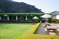 Landscaped Garden with Dining Tables Royalty Free Stock Photo