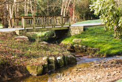 Landscaped Garden with a Wooden Bridge and a Creek Royalty Free Stock Photos