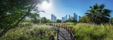 Landscaped Green Island - a Nature Reserve with a Panorama of the City. Island - Butterfly Park, Sharjah, Emirates, Feb.2018 Royalty Free Stock Photos