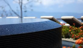 Luxury infinity pool and lounge chairs at Costa Rican premium travel hotel poolside. A landscaped high definition photo of resort hotel swimming pool with Royalty Free Stock Photography