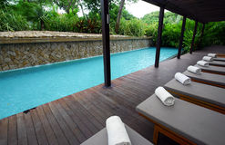 Landscaped hotel swimming pools and loungers
