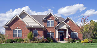 Landscaped Red Brick Home Stock Photos