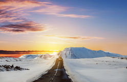Landscaped, road trip on the country road in sunrise. In Iceland in winter Royalty Free Stock Photo