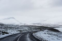 Landscaped of the road in winter, with blizzard storm coming Royalty Free Stock Photo