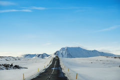 Landscaped the road in winter, with a cars driving on highway in Iceland Stock Images
