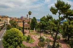 Landscaped square with buildings and street in the city center of Grasse. Landscaped square with buildings and street in the city center of Grasse, a friendly royalty free stock images
