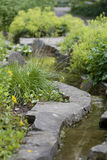 Landscaped stream in garden Royalty Free Stock Photo