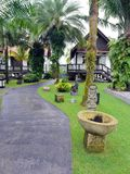 Landscaped tropical resort garden. A photograph showing the beautiful lush green garden of a tropical resort hotel with individual villas in the garden with Stock Photography