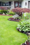 Landscaped Yard. Beautifully landscaped garden filled with perennials and annuals Stock Photos