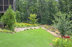 Landscaped Back Yard. A landscaped yard with flowers and garden on a sloping lot royalty free stock photo
