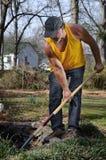 Landscaper. Digging a pond in a backyard Stock Photo