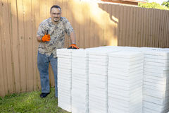 Landscaper, Gardener With Concrete Pavers. Landscaper, gardener giving thumbs up, ready to lay down concrete pavers Stock Photos