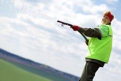Landscaper gardener watering lawn. Landscaper woman gardener watering lawn with hose Stock Photos