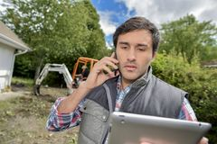 Landscaper on the phone. Young Stock Photography