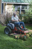Landscaper on riding lawn mower Stock Image