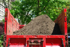 Landscaper Truck. A landscaper truck filled with soil, in a New York City park stock photos