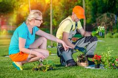 Landscaper Working with Client. Gardener Landscaper Working with Client Taking Orders and Listening Clients Ideas For New Garden Development. Landscaping Royalty Free Stock Photos