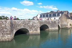 Landscapes and architectures of Brittany. Auray, France - August 7, 2017: The ancient Saint Goustan bridge near the harbor in the center of the village Royalty Free Stock Photo