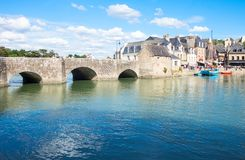 Landscapes and architectures of Brittany. Auray, France - August 7, 2017: The ancient Saint Goustan bridge near the harbor in the center of the village Stock Photos