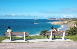 Landscapes and architectures of Brittany. Cap Frehel, France - August 8, 2017: Young people relaxing looking at the Emerald coast landscape Stock Photo