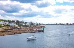 Landscapes and architectures of Brittany. Concarneau, France - August 10, 2017: Leisure boat in the access channel to the fishermen harbor Stock Photography