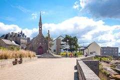 Landscapes and architectures of Brittany. Concarneau, France - August 10, 2017: People in front of De La Croix chapel in De La Croix seafront Royalty Free Stock Images