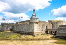 Landscapes and architectures of Brittany. Concarneau, France - August 10, 2017: View of the ramparts and the clock tower of Ville Close valled city Royalty Free Stock Image