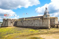 Landscapes and architectures of Brittany. Concarneau, France - August 10, 2017: View of the ramparts and the clock tower of Ville Close valled city Stock Image