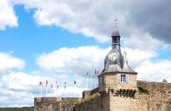 Landscapes and architectures of Brittany. Concarneau, France - August 10, 2017: View of the ramparts and the clock tower of Ville Close valled city Stock Photo