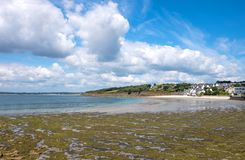 Landscapes and architectures of Brittany. Concarneau, France, vie of the coastline with the White Sand beach in the background Royalty Free Stock Photos