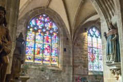 Landscapes and architectures of Brittany. Locronan, France - August 10, 2017: The large stained glass windows of the  St Ronan churchchurch Stock Photos