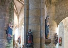 Landscapes and architectures of Brittany. Locronan, France - August 10, 2017: Statues of Saints in the nave of the St Ronan church Royalty Free Stock Photo