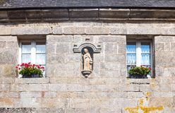 Landscapes and architectures of Brittany. Locronan, France, the facade of a traditional medieval house in Eglise square Stock Images