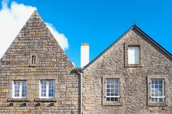 Landscapes and architectures of Brittany. Locronan, France, upward view of the facade of a traditional medieval houses in Lann street Royalty Free Stock Photography