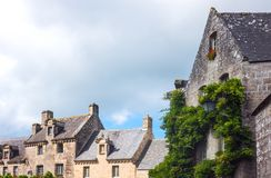 Landscapes and architectures of Brittany. Locronan, France, view of the traditional medieval houses in Eglise square Stock Photography