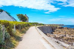 Landscapes and architectures of Brittany. Portivy, France, the path that runs along the sea towards the port Stock Images
