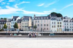 Landscapes and architectures of Brittany. Vannes, France - August 7, 2017: The houses and venues of  Le Dressay street along the canal of the port Stock Photography