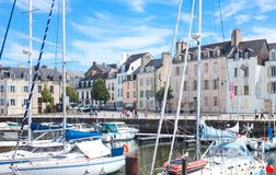 Landscapes and architectures of Brittany. Vannes, France - August 7, 2017: The houses and venues of  Le Dressay street along the canal of the port Royalty Free Stock Photography