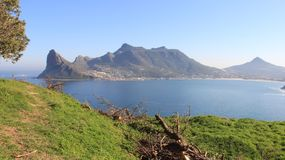 Landscapes Blue Sea And Rocky Mountain With City View. Rocky mountain and Atlantic sea cape point with blue sky and warm sunshine in South Africa royalty free stock photos
