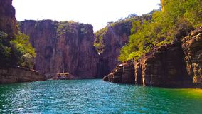 Landscapes of capitolio mg canyons, photo recorded inside a boat taking a blue water with rocks in its return with some vegetation stock image
