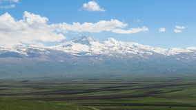 Landscapes and Mountains of Armenia. Clouds move over the Snowy Peaks of the Mountains in Armenia. Time lapse stock footage