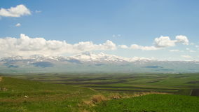 Landscapes and Mountains of Armenia. Clouds move over the Snowy Peaks of the Mountains in Armenia. Time lapse stock video footage