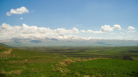 Landscapes and Mountains of Armenia. Clouds move over the Snowy Peaks of the Mountains in Armenia. Time lapse. Summer, Sunny day stock video footage