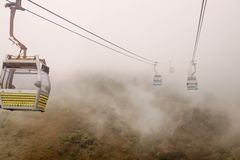 Landscapes Nong Ping Cable Car with smog royalty free stock photo