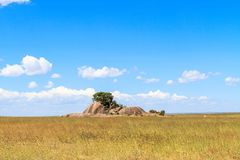 Landscapes of Serengeti. Clouds and stones on endless plain. Tanzania, Africa Stock Photo