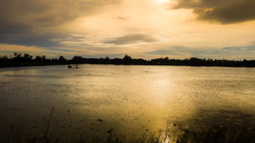 Landscapes of Shallow lakes and trees with the sun set Royalty Free Stock Photos